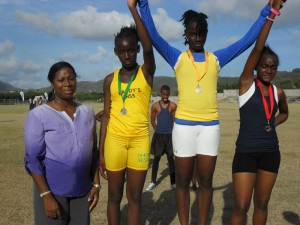 Minister Pierre with winners of the 100m sub-junior girls' race