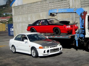 """Left: Joshua Lewis' TOTAL Lubricants' Mitsubishi Lancer Evolution IV Right- Alan Mc Intyre's """"Sledge Hammer"""" Ford Mustang"""
