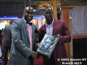 Junior Murray receives award from Dr Anthony Bridgeman of the GBSS Alumni-NY