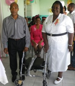 President of Calabash Promotions presents Rollator to nurse in charge of the home