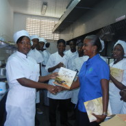 Dayliah Henry-Banthorpe presents books to culinary students