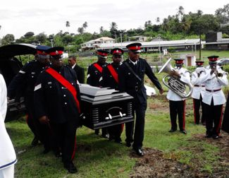 Members of the Police Force removing casket from the undertaker for placing in the tomb