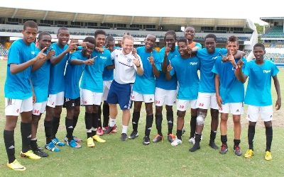 Team Lampard Coach, Oliver Woodall, celebrates with his team