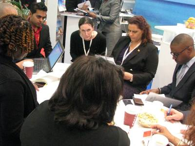 Grenada Tourism Minister in discussion at WTM 2013