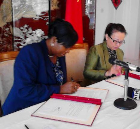 Youth Minister Emmalin Pierre and Chinese Amb Madam Ou Boqian signing the agreement for the financial assistance