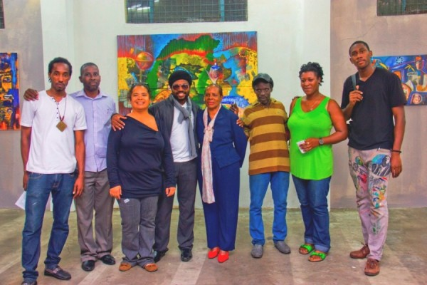Group photo at the opening with collaborating artists and Senator Brenda Hood, Parliamentary Secretary for Culture (Nico, Roland, Suelin, PrensNelo, Senator Hood, Doliver, Andrea and Teddy)