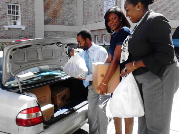 NIDCU rep packing groceries donated into vehicle