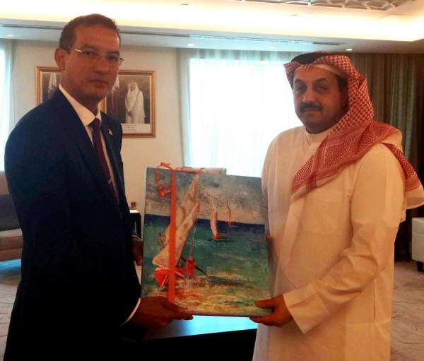 Minister Steele presents painting by Susan Mains to His Excellency Dr Khalid Bin Mohammed