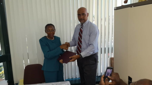 Merina Jessamy, PS Ministry of Agriculture and Byron Campbell, Programme Manager at MAREP at the signing ceremony