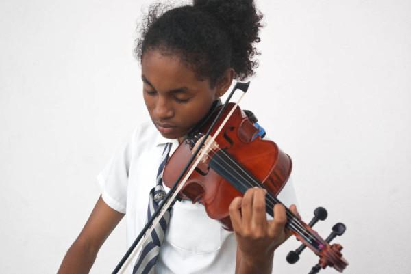Island Violin Student, Anastasia Winsborrow Rehearsing at Sound Check