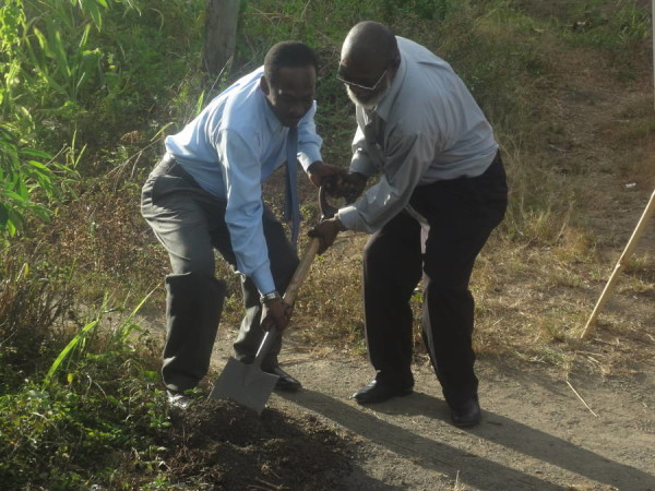 Minister Boatswain turns the sod with MAREP's Bauxton Francois