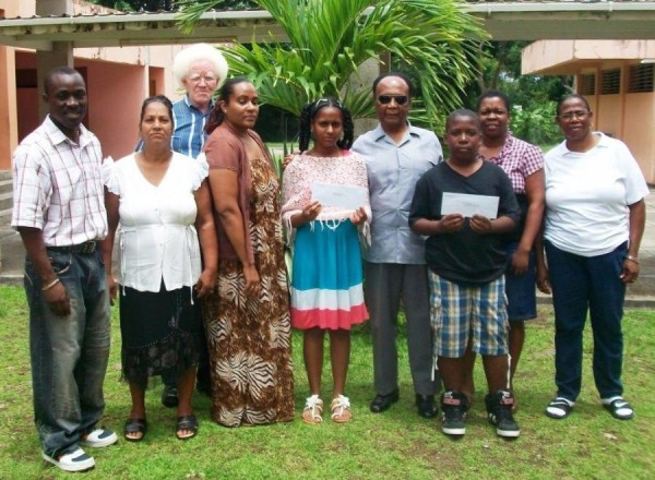Norris Mitchell with awardees, their parents and school principals
