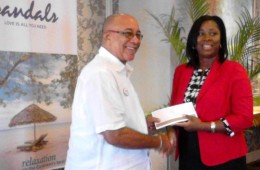 sandals presenting cheque