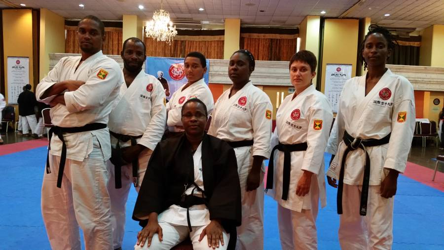 Sensei Joseph flanked by team members, (L–R) Tisagh Chase, Byron George, Christian Chow Chung, Racquel Ratoo, Anya Chow Chung and Adanna Moore