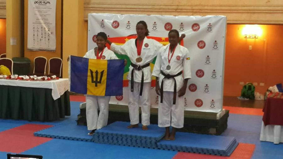 The Grenadian women receive their silver medal