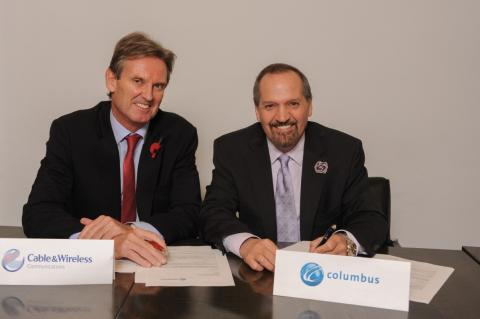 Stronger, faster, smarter: Phil Bentley, Chief Executive Officer of Cable and Wireless  Communications (left) and Brendan Paddick, CEO and Chairman of Columbus Communications are all smiles after inking the proposed merger agreement between both companies earlier today in London.