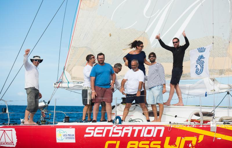 A jubilant crew on Sensation Class 40 celebrate their arrival - RORC/Arthur Daniel & Orlando K Romain