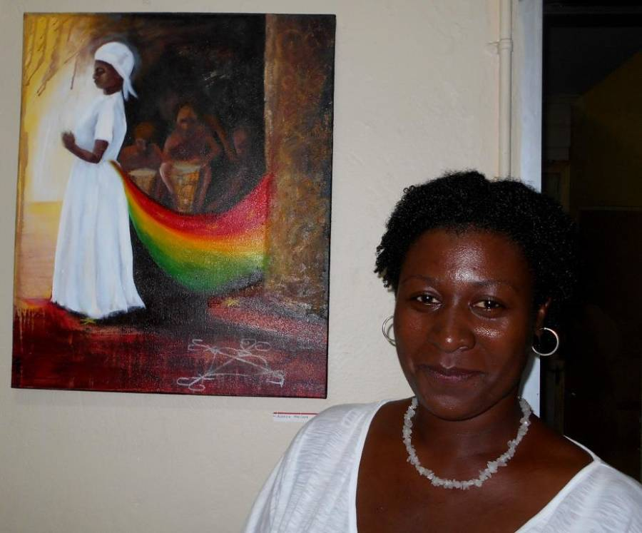 Andrea McLeod with her exhibition piece depicting the Grenada national colours. Photo - Suelin