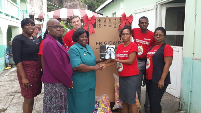 Digicel Finance Department making presentation to their charity , The Richmond Hill Home for the Elderly.