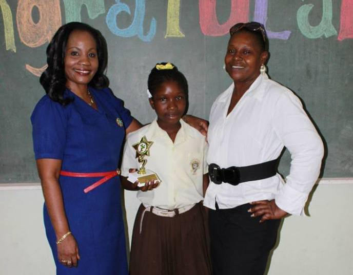 Winner Priya Campbell with Principal & Class Teacher. Photo by A Moore
