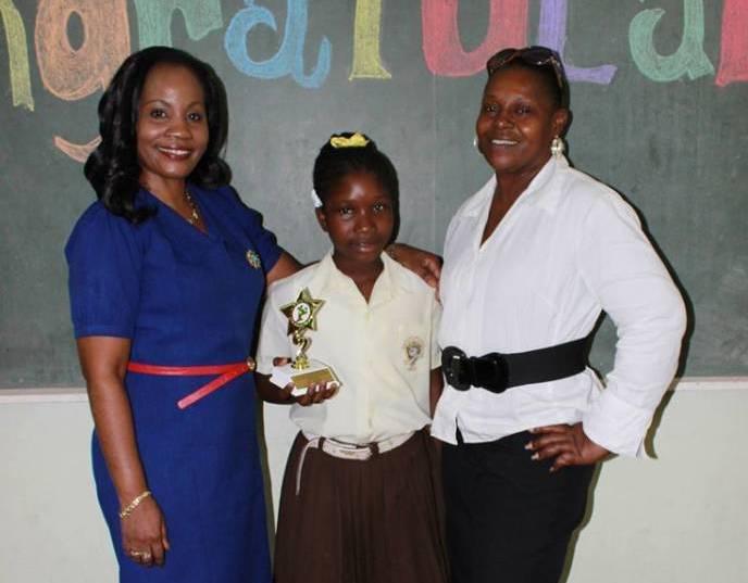 Winner Priya Campbell with Principal & Class Teacher. Photo by A Moore