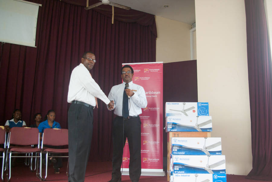 CIBC FirstCaribbean Country Manager Nigel Ollivierre Presents Fans to School Principal Phillip Thomas