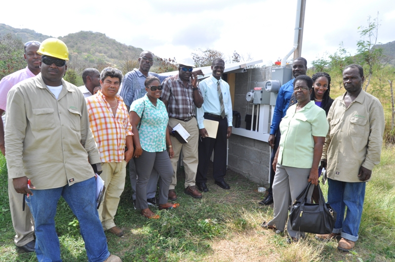 Employees of the Ministry of Carriacou and Petite Martinique Affairs along with workers of GRENLEC at the connecting of the  solar system