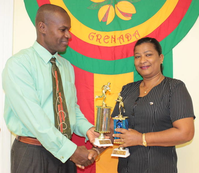 NLA's General Manager – Mr Geoffrey Gilbert handing over Trophies to Representative form St Joseph's RC School (Morne Jaloux)