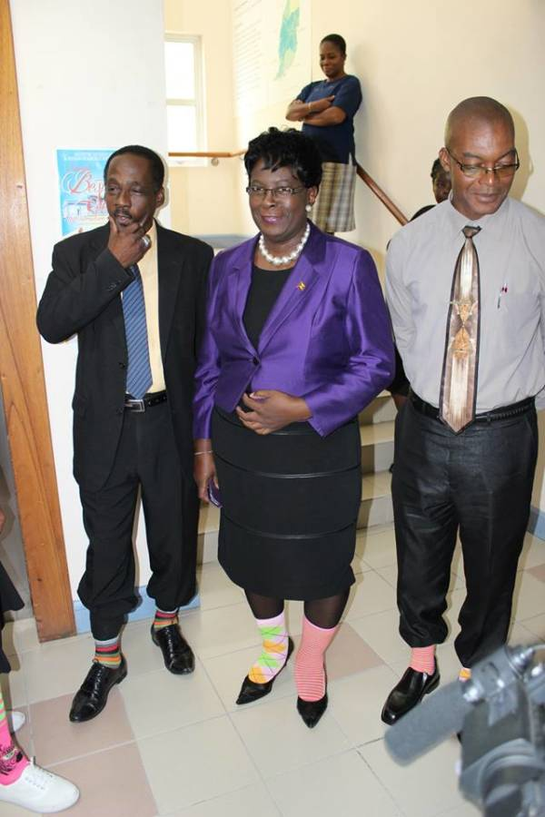 MINISTER, P.S. & CEO display their socks