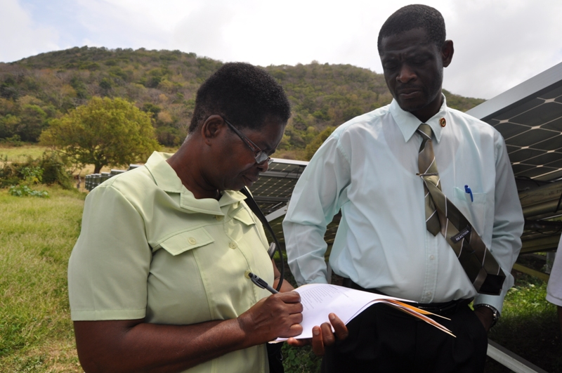 Senior Administrative Officer Marie Alexis signs agreement with GRENLEC