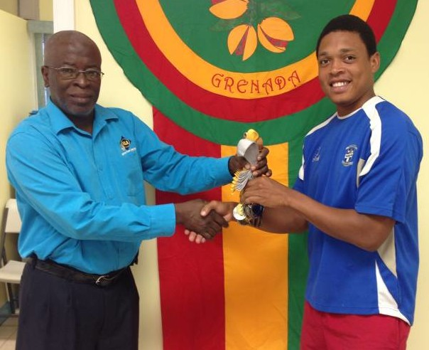NLA's Accountant – Mr. Carl Phillip handing over Medals and to Representative from St. George's Anglican Junior School.