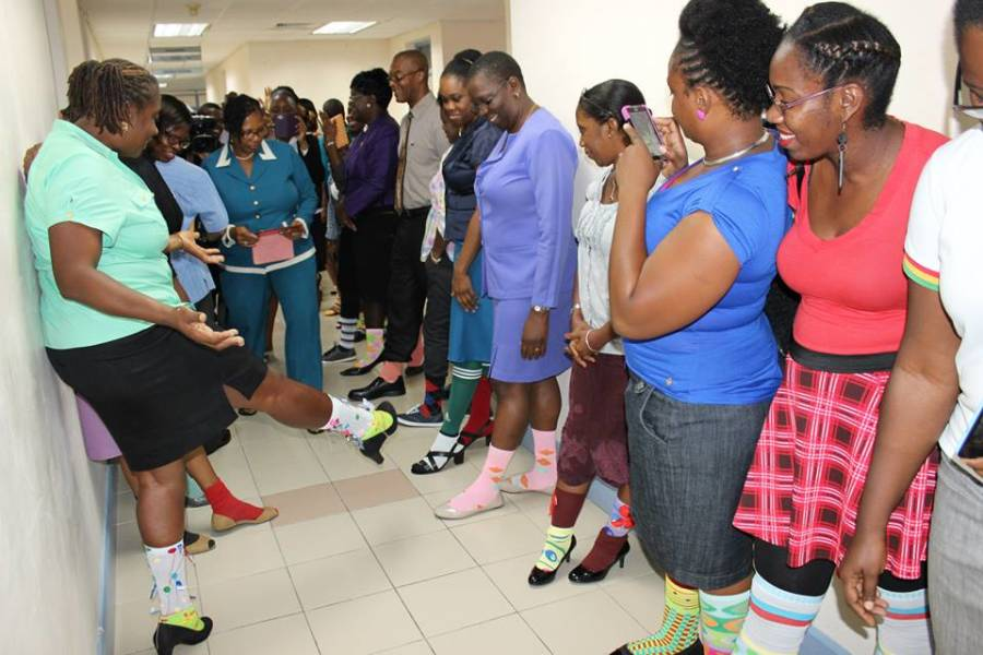 Winner of sock competition, Ms. Judy Bowen, being judged