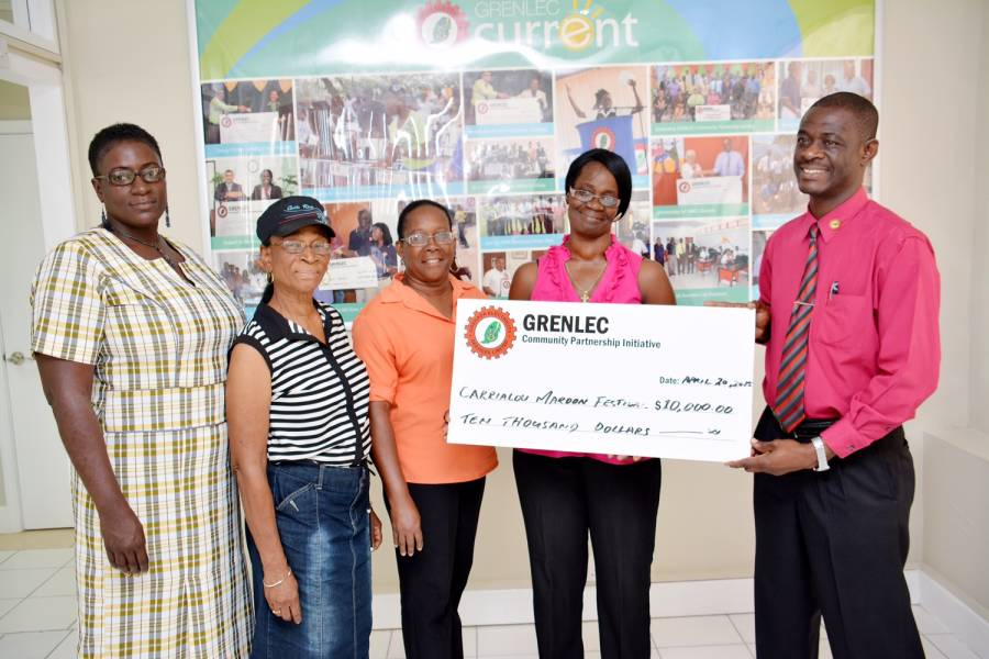 Maroon Music Festival President, Ms. Faithlyn George Recives Cheque.