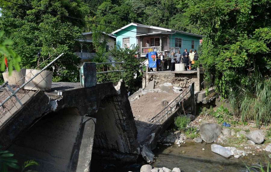 British Prime Minister David Cameron visits a damaged bridge in Grenada which has only just recently collapsed entirely.