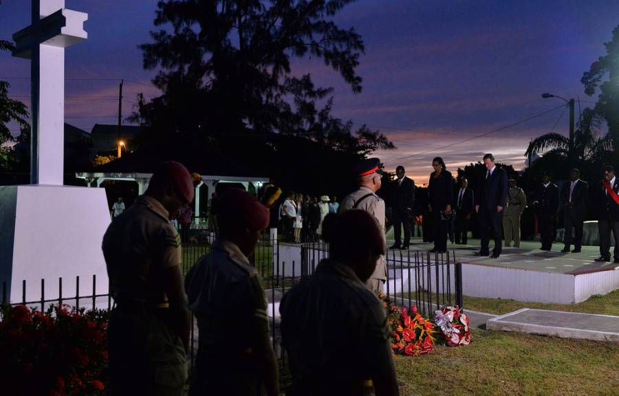 David Cameron walks with Prime Minister Mitchell through Botanical Gardens and lays a wreath as part of a memorial service held at sunset. Also present, Her Excellency Dame Cécile La Grenade, Governor General of Grenada. Photo by Georgina Coupe, Crown Copyright