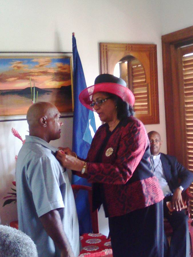 Coach Albert Joseph Receiving his Insignia
