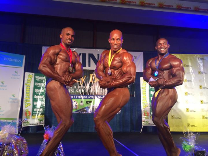 Damion Daniel first place winner accompanied by second and third place holders respectively.