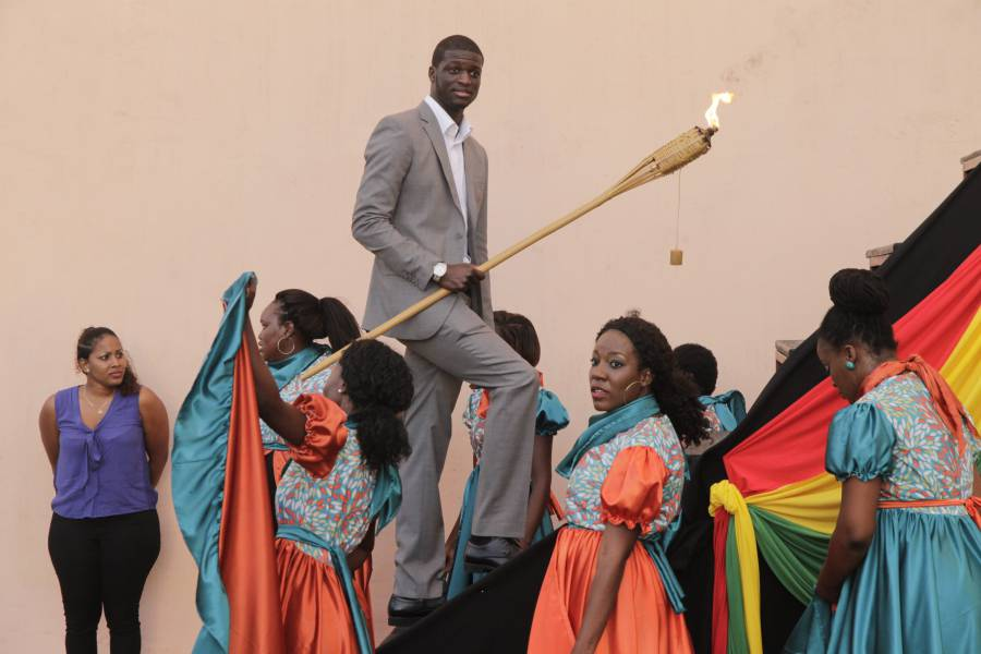 Kirani James carrying the torch at the opening of the Grenada Athletic Stadium
