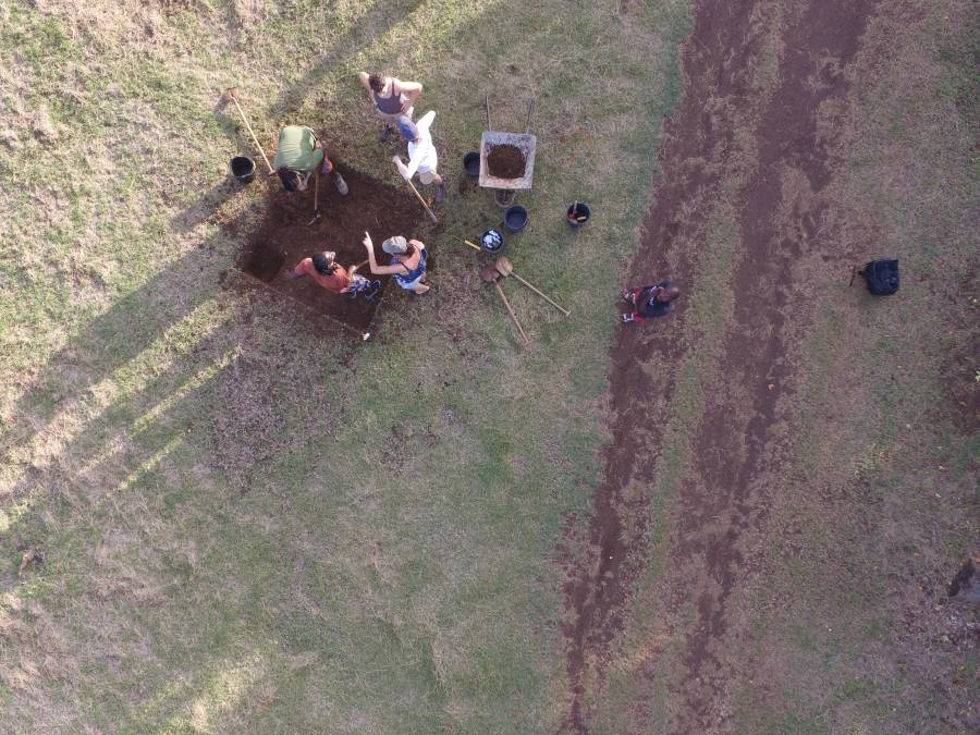 Aerial view of a test pit being excavated at La Poterie