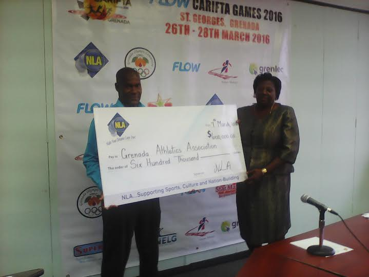 NLA presenting cheque to Chairman of the LOC for Carifta Veda Bruno-Victor