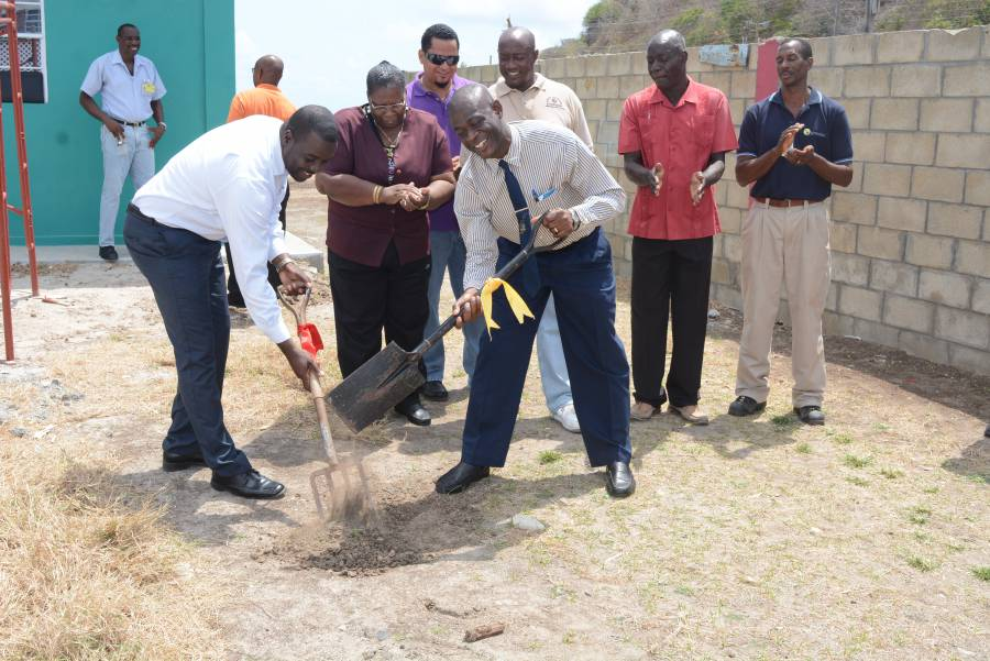 Sen. Norlan Cox and Grenlec's Wallace Collins Mark Start of Public Toilet Construction in Petite Martinique