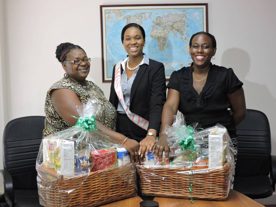 Ruth Bailey Donates Food Hampers to GNCD. Hillary Garbiel L and Carlene ...