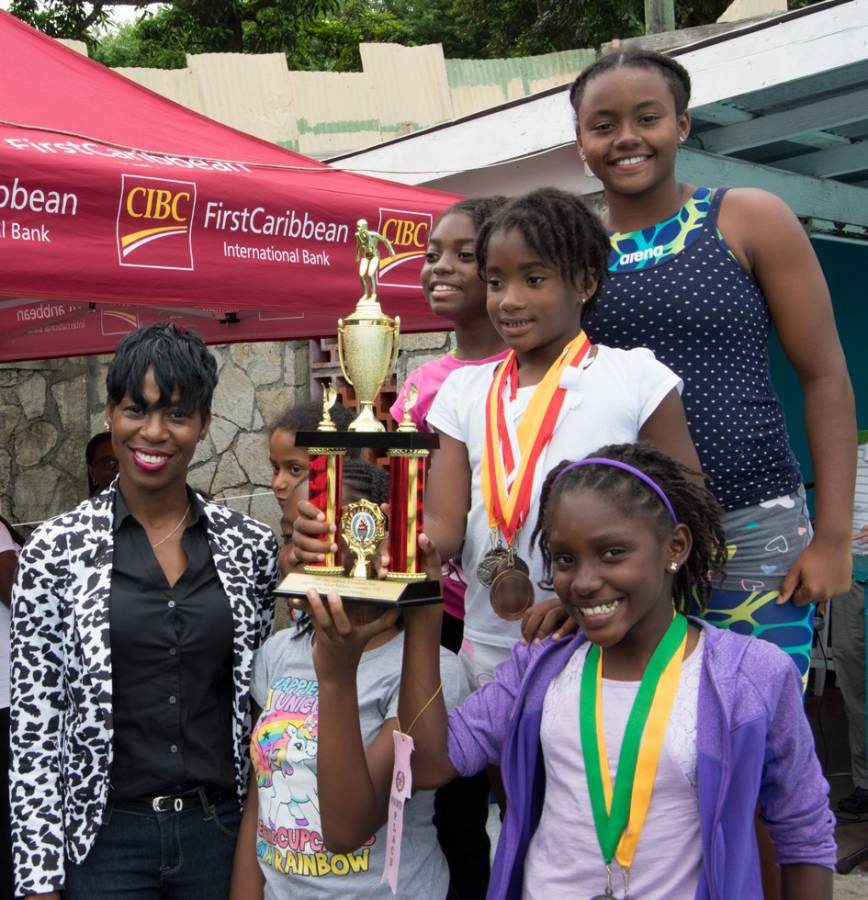 CIBC FirstCaribbean Customer Service Manager St. Geo Matonia James Presents Trophy to the Top Female Swim Team St Marys Junior School