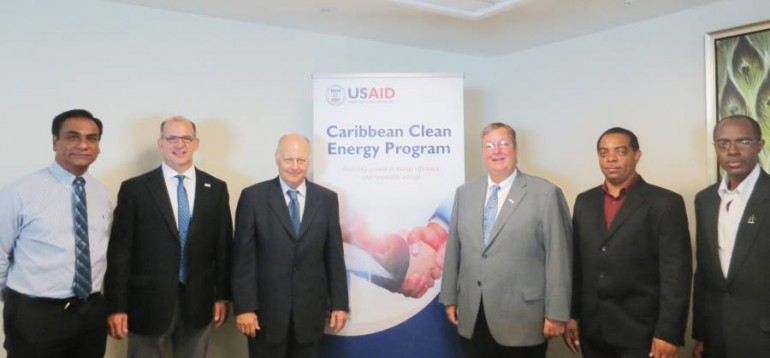 Workshop participants pose for a photo after the USAID CARCEP program