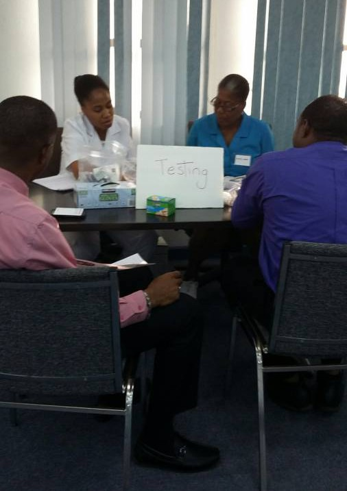 Men at seminar being tested by medical professionals