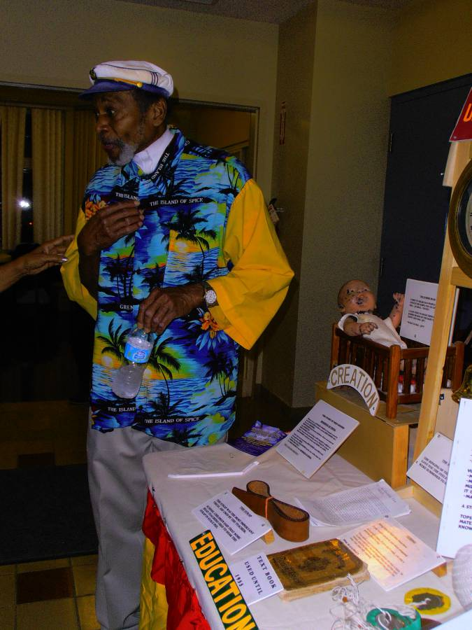 Dudley Hood showcasing his mobile museum that shows a Royal Reader on the table