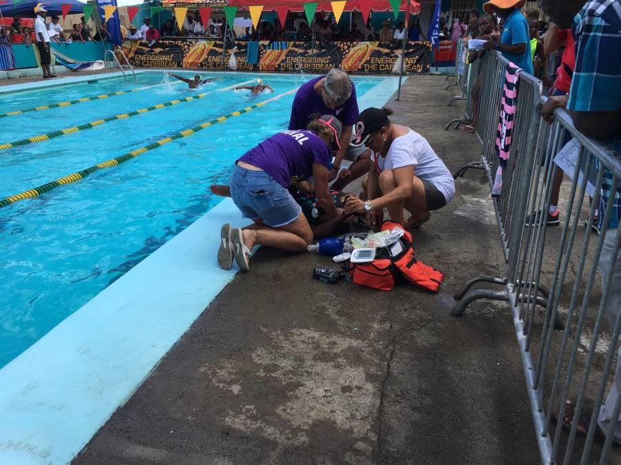 Drs Noel, Noel & Nelson attending to ailing swimmer