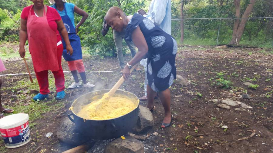Senator Brenda Hood stirring cou cou at Saraka preparations