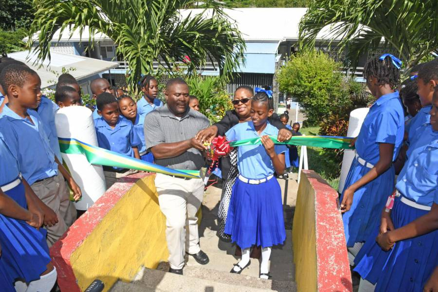 Grenlec Shawn McQuilkin, Principal Augustus Sylvester and student cuts ribbon