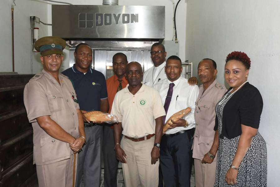 Prison officials along with representatives from grenlec and NLA and Genevieve Gibbs